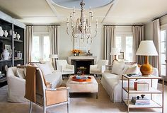 Creamy whites, soft taupes, a hint of muted orange: This look proves that you don't need bold hues to make a gorgeous statement. From slipcovered sofas to rugs in serene hues, the pieces here will have you embracing the quiet beauty of neutrals.