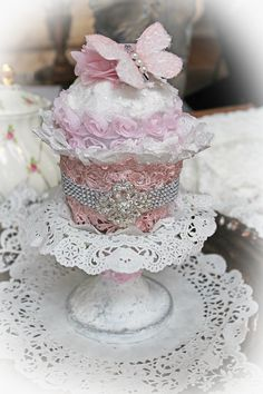 "A Delicious Treat I ""baked"" up using lots of YUMMIES from the Reneabouquets.com and Reneabouquets Etsy. Calorie free and Oh So YUMMY <3 You can check out the details on my blog: http://wwwmyglittercoatedlife.blogspot.com  Items used from  Reneabouquets :Prima White Crackle Texture Paste, Blush Pink Lace, Anastasia Brooch,  Ranger Texture Paste, Dina Wakley Palette Knife, Reneabouquets Diamond  Glitter Glass, Shabby Chic Chiffon Flower, TT Sweet Pea Butterfly http://www.Reneabouquets.com"