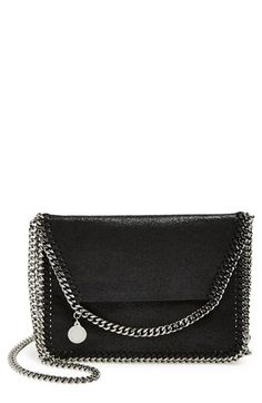 Free shipping and returns on Stella McCartney 'Mini Falabella' Shaggy Deer Crossbody Bag at Nordstrom.com. Draped chains lend signature sophistication to a sized-down crossbody bag crafted in Italy with a shimmer-struck finish and polished, logo-etched hardware.