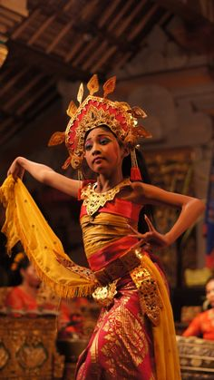 Traditional Balinese dancer in Ubud, Bali, Indonesia. A dance school for girls on the island of Bali, the mothers of this dance group play the music whilst their daughters are learning the traditional dances of the Balinese culture.