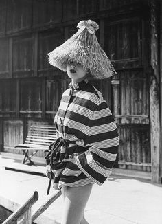 Actress Ingrid Mirbach in striped beach cover-up and straw hat, photo by Regina Relang on the island of Sylt, 1949