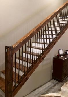 Rustic Old utility pole cross arms reclaimed into Stair railing with rebar used as spindles. An idea for the stair railing! Interior Stair Railing, Stair Railing Design, Staircase Railings, Railing Ideas, Banisters, Rebar Railing, Metal Spindles, Staircase Ideas, Stairways