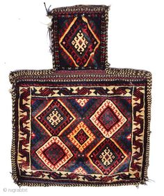 A Persian, Kurdish salt bag, the central panel with five hooked polychrome diamonds within a stylised animal border on a white ground with banded flat weave back, 66 x 53.5cm