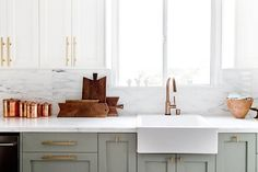 classic cabinetry paired with marble, white, gray, and copper make for a fresh and airy kitchen
