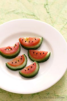 veggie watermelons Sliced halved cucumbers topped with halved tomato slice nigella (kalonji) seeds.