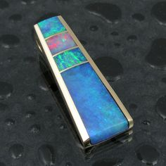 Pendant | Mark McBride Hileman. 14k gold,  blue green opal and one piece of fiery red opal inlay