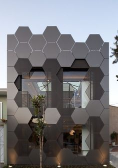 Estar Móveis store in Sao Paulo, Brazil by SuperLimão Studio - intriguing facade made of perforated and opaque hexagonal metal panels: