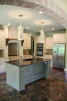 Brick accents, island color, stained mantel & pendants blend nicely