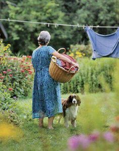 Woman with wash basket and hang laundry
