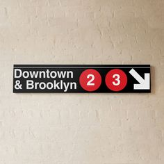 Downtown & Brooklyn Sign 23 // $200 Found all throughout NYC, your typical MTA sign is easy to take for granted, but in a more subjective way, these signs are some of the best examples of Helvetica in it's purest, most refined form. The Downtown and Brooklyn sign is for all design aficionados who simply acknowledge and appreciate the beauty of New Yorks's best typography at work.