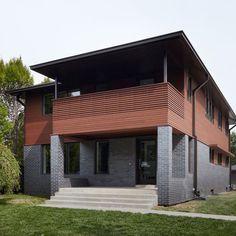 Wood and grey brick exterior