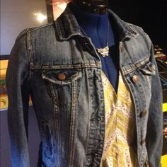 American Eagle Distressed Denim Jacket, Mid Blue There's nothing more comforting than a really hard-wearing jean jacket. It's the barrier between you and the world--a second skin. You're ten feet tall and bulletproof with a trusty denim shell. Not literally, of course, but you get the idea. This one is lightly distressed with a shorter length. Basic, and a perfect topper for virtually any outfit. Great, lightly used condition with no (unintentional!) flaws. American Eagle Outfitters Jackets…