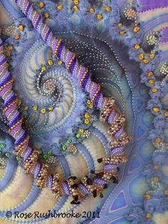 Necklace laid over Royal Crustacean fractal art quilt
