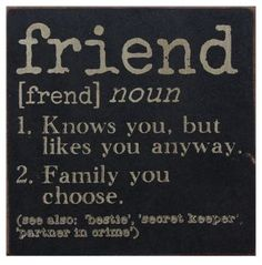 """Our Definition of a Friend Sign is printed on a black wooden box with burgundy borders and lightly distressed edges. It reads: """"Knows you, but likes you anyway"""" and """"Family you choose"""". It can be free"""