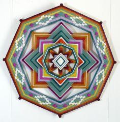 Spruce Delight, a 16 inch Ojo de Dios, yarn mandala