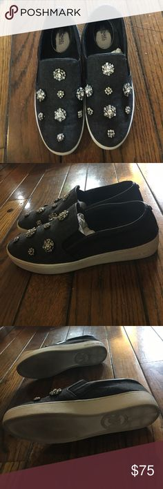 Michael Kors grey embellished slip on sneakers Michael Kors grey slip on sneakers with crystal floral embellishment. Worn once. In good condition MICHAEL Michael Kors Shoes Sneakers