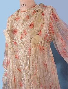 Circa 1900 FERNANDE BUREL, PARIS Floral Silk Chiffon Victorian Fancy Trained Dressing Gown. Pink roses silk chiffon, extra fancy design, gathered into fleur-de-lis / four-leaf clover lace inserts, empire waist, trained back, silk ribbons. Comes attached to the original underslip of off-white tissue china silk, button front. Complete with the Parisian label. (Detail)
