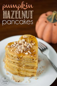 Pumpkin Hazelnut Pancakes | Self Proclaimed Foodie - made with pumpkin puree and toasted hazelnuts, they're everything a Fall morning should be.
