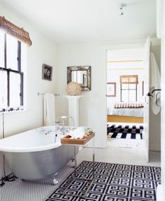 A decorative tray next to the bathtub keeps your bathroom essentials nearby. | http://domino.com