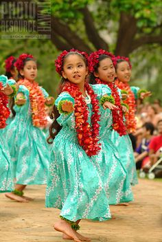 Keiki hula  and praise dancers from Halau Hula O Hokulani dancing  to praise songs  at the Kapiolani park.