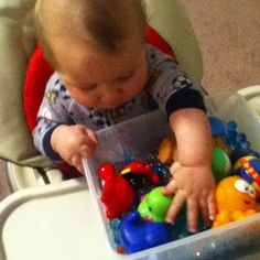 Carter's newest sensory bin! (fish tank) his bath toys and some gel beads I got from the dollar store :D