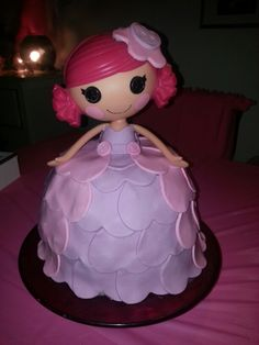 Lalaloopsy cake, I like the idea of layering cutouts instead of trying to cover the whole dress in fondant.