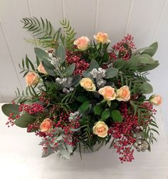 Wild and natural arrangement with roses, peppercorn berries, roses, eucalyptus, and silver dusty miller. Flowers by Alba Roses, www.albaroses.com.au