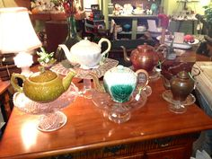 Teapots of all sorts.  Antique majolica, vintage Beleek with seashells, circa 1855 copper big and small.