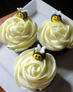 Honeybee and Rose Cupcakes - These lovely roses attract honeybees in search of sweet nectar. User clemmercupcakes created the cupcakes for a baby shower -- the mother-to-be requested anything but pink for her baby girl.