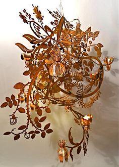 Crushing on @tordboontje 's gorgeous chandelier: illuminated flowers, rusty branches. #want http://goo.gl/XZvNnL