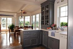Grey Kitchen Cabinets White Appliances: Gray kitchen cabinets with white…