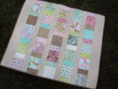 Charm squares baby quilt - http://sewmamasew.com/blog2/2009/10/elizabeths-fabric-focus-charm-squares-baby-quilt/
