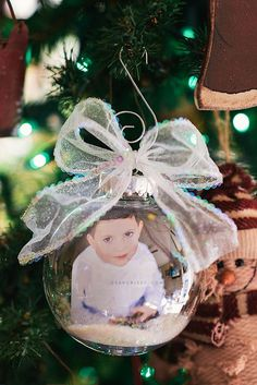 Want to get crafty this holiday season? Preserve precious memories with this super easy Christmas tree ornament craft using photo prints from Walgreens!