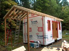A x Garden Storage shed with an overhang for firewood storage. Clad with Eastern white pine board and batten. The Shed has a continuous ridge beam site built) that cantlevers. Pallet Shed Plans, Shed Plans 12x16, Free Shed Plans, Garden Storage Shed, Storage Shed Plans, Cabana, Cedar Shed, Shed Frame, Pool Shed