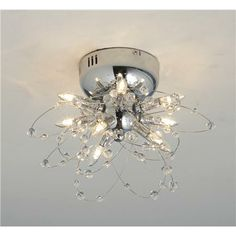 Maybe as a wall sconce.... Squiggle and Crystal Glam Flush Mount Ceiling Light - 9 Lt - Shades of Light