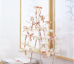 Artificial white tree with candy canes and bows. Nice for office or small apartment. Even a school class effect.