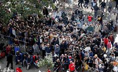 Refugees queue at the compound outside the Berlin Office of Health and Social Affairs as t...