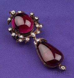 Antique Garnet and Diamond Pendant, c. 1850, bezel-set with a round carbuncle suspending a pear-shape carbuncle, highlighted by old mine and rose-cut diamond garland and leaf motifs, silver-topped 14kt gold mount, together with a later 9kt gold trace link chain, lg. 2 1/3 in., fitted S.J. Phillips box.