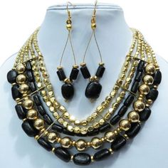 """Beautiful and gorgeous handcrafted gold tone metal necklace earring set. This is very attractive belly dance necklace set and look extremely elegant yet antique in you. This Jewelry add more charm to your jewelry collection. This necklace is beaded with black acrylic stones. You can wear this necklace set jewelry at any party or at any occasion to look more beautiful and gorgeous. Necklace Length -10 InchEarrings Length - 2.5"""" Inch"""""""