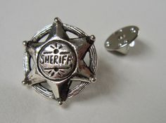 Sheriff Star, show em whos boss!  I love this piece as a pin.  When I wear mine, I walk a little taller, imagine the spurs my boots clicking as I walk - and the saloon emptying when I walk in... ; )   Measures: 2cm x 2cm  #Sheriff #Pin #boss #charmedandcherished