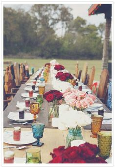 gaga's glasses are in there! The Boho Dance: Beautifully Bohemian Wedding Decor: Mismatched chairs, frosted jewel tone glasses, plus lush red roses make this a lovely outdoor bohemian spread. Brooke Schwab Photography via 100 Layer Cake Bohemian Wedding Decorations, Reception Decorations, Boho Wedding, Dream Wedding, Table Decorations, Wedding Vintage, Decor Wedding, Bohemian Weddings, Bohemian Bride