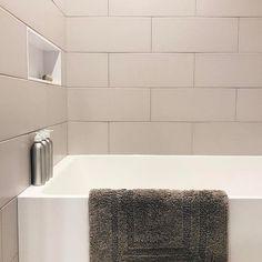 Bath time at our Coal Harbour Reno . Corian, Bath Time, Minimalist Design, Bath Mat, Minimalism, Tile, Bathtub, Interior Design, Bathroom