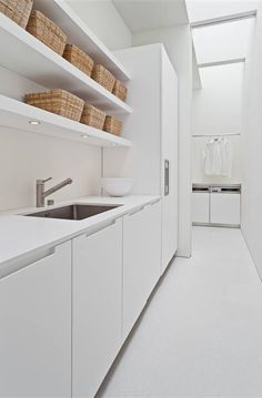 Color: 25 Fabulous All-White Rooms This minimalist kitchen is immaculate.This minimalist kitchen is immaculate. White Laundry Rooms, Modern Laundry Rooms, Small Laundry, Laundry In Bathroom, All White Room, White Rooms, White Space, Minimalist Kitchen, Minimalist Interior