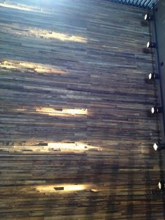 Exterior ideas... wooden slats with horizontal beams of warm light
