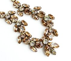 Hey, I found this really awesome Etsy listing at http://www.etsy.com/listing/124741724/sale-vintage-clear-topaz-rhinestone