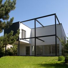 contemporary structure formed by using filled and empty quadrilaterals dichotomy of black and white accents