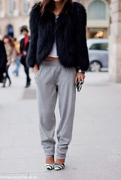 High glam faux fur with a low key T-shirt and slouchy pants. Love it.