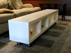 Ikea Hack: Lack shelving turned into coffee table with casters.
