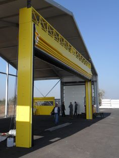 Shipyarddoor is a company specialized in serving on the hangar door. Steel and aluminum are used as the wind is not affected by adverse weather conditions. With a special transmission and engine systems can get these products at an affordable price.  http://www.shipyarddoor.com/