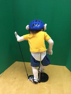 The delivery time right now is about 6 to 8 weeks. This is a small Jeffy Jeffy puppet. He is 20 inches. The pictures are just samples of what the puppet can look like. All puppet comes with helmet, yellow shirt with Jeffy written on it, jeans( the jeans do not come of), diaper, pencil and socks. No shoes ,no rod. There are other options to ad on sneakers and rod. This puppet is small and would fit nice on a childs hand. This puppet is about 4 to 5 inches smaller than the large Jeffy puppet…